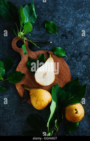 Wooden cutting board with pears - Stock Image