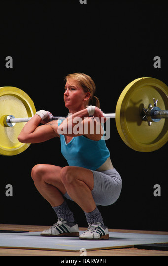 Female Olympic style weightlifter in action - Stock Image