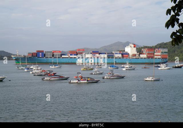 Panama Panama City Amador Panama Canal Balboa Yacht Club marina anchored boat vessel cargo container ship navigation - Stock Image