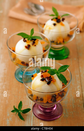 Soft cheese with coconut and dried fruits. Recipe available. - Stock Image