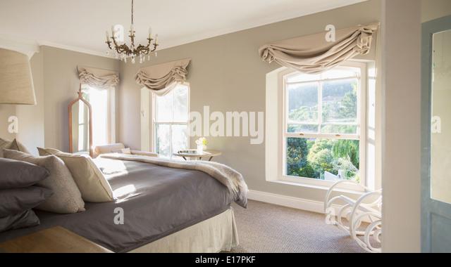 Sunny luxury bedroom - Stock Image