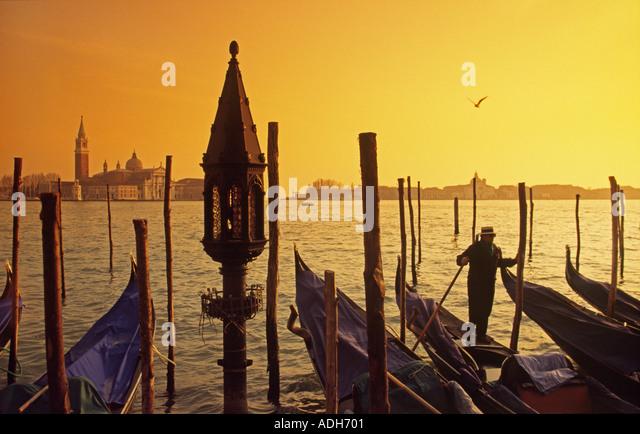 Italy Venice Riva degli Schiavoni Canale Grande Riva degli Schiavoni Gondola pier sunset - Stock Image