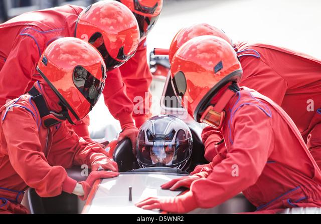 Racing team working at pit stop - Stock-Bilder