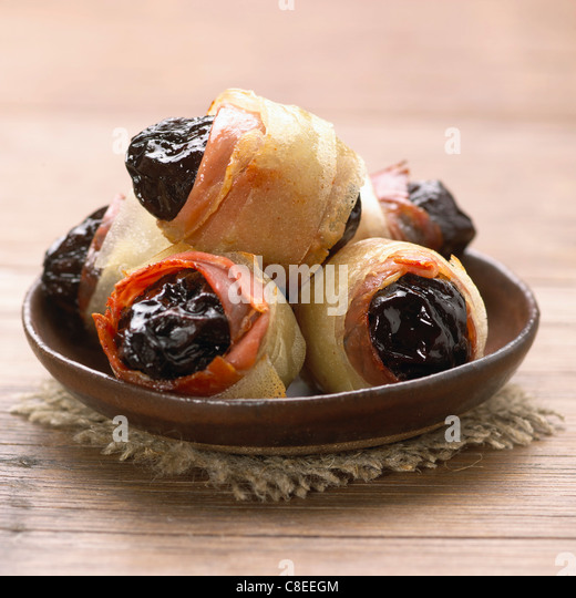 Bacon and filo pastry plum rolls - Stock Image