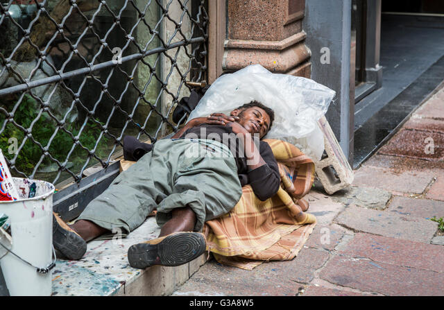 A worker resting on the street in Montevideo, Uruguay, South America. - Stock Image