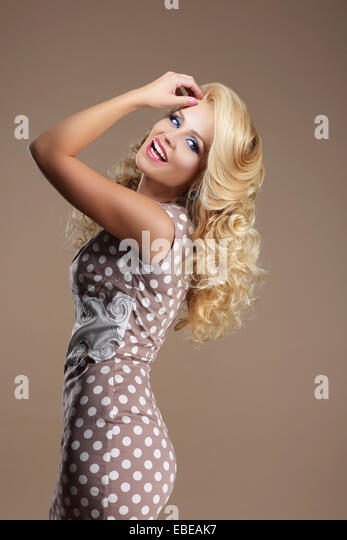 Toothy Smile. Sophisticated Lucky Woman in Classic Dress - Stock Image