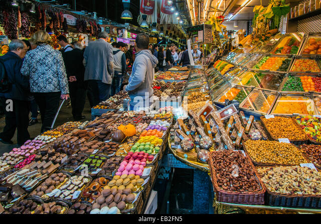 Dried fruit and candies stall at Boqueria food market, Barcelona, Catalonia, Spain - Stock Image