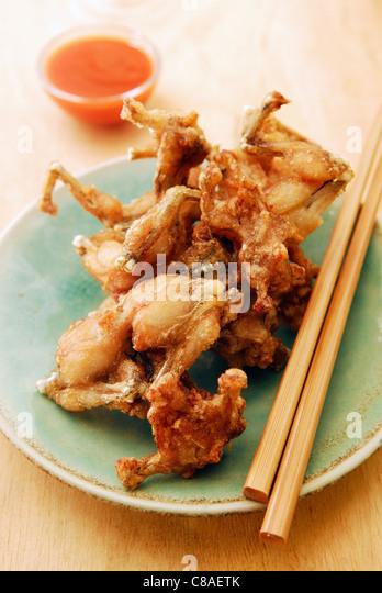 Deep-fried frog's legs - Stock Image