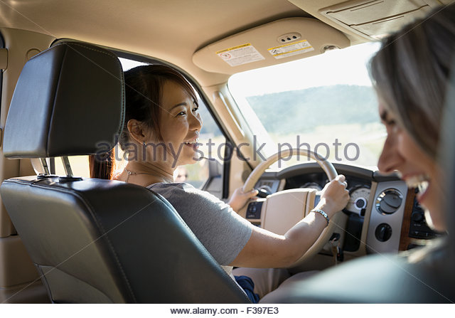 Laughing women driving in car - Stock Image