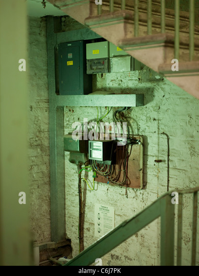 Collection of fuse box and electricity meters in an old building - Stock Image