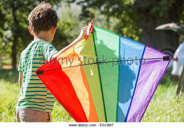 Young Boy Flying Kite On Holiday In Countryside - Stock-Bilder