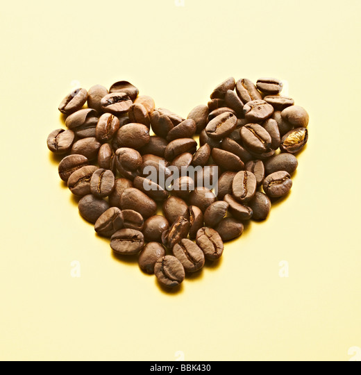 A heart shape of luxury coffee beans. - Stock Image