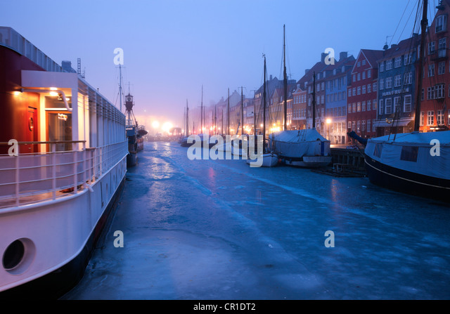 Denmark, Copenhagen, Nyhavn district on early winter morning - Stock Image