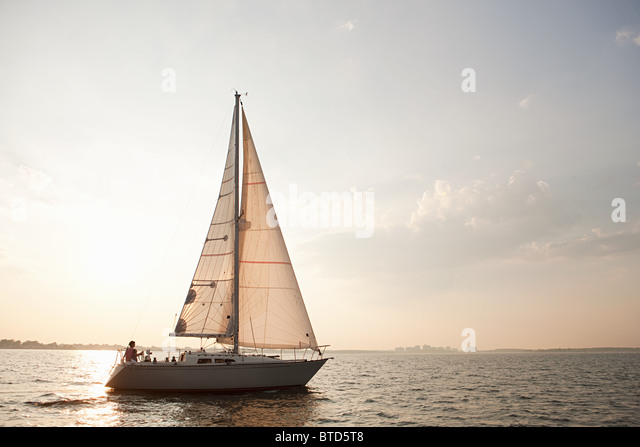 Yacht sailing on sea - Stock-Bilder