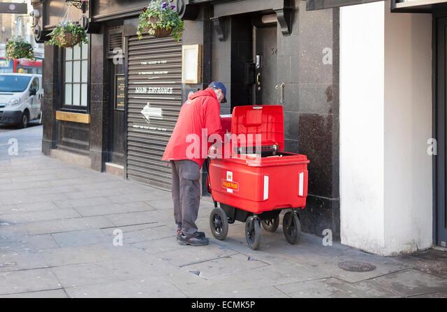 A Royal Mail postman, London, England - Stock Image