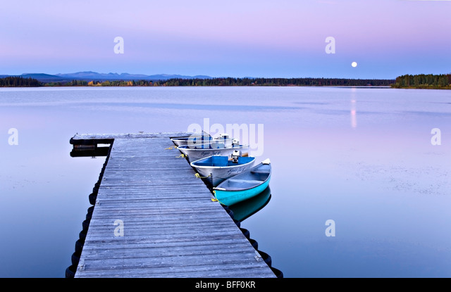 Full moon over wharf at Anahim Lake British Columbia Canada - Stock Image