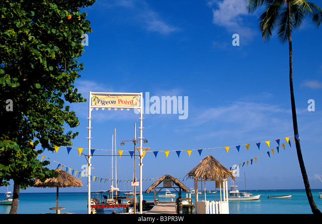 Tobago Pigeon Point heritage park thatch-roofed jetty boat dock iconic island symbol signature site landmark - Stock Image