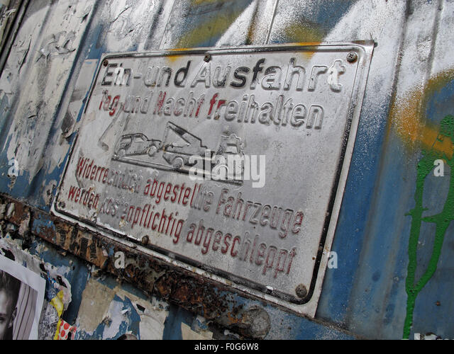 Berlin Mitte,Street art on walls,Germany Ein-und Ausfahrt sign sprayed with graffiti - Stock Image