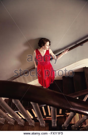 Vintage 1940s woman standing on stairs - Stock-Bilder