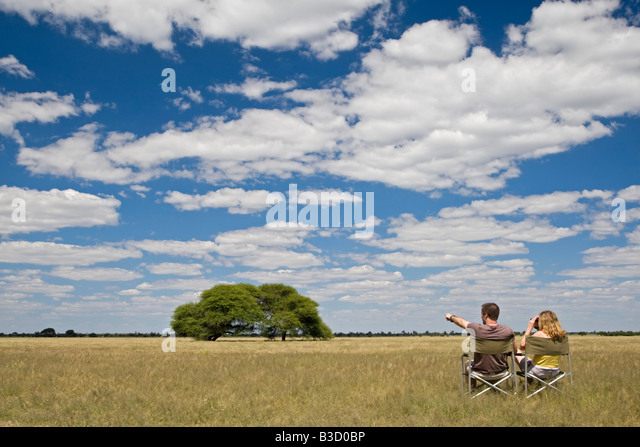 Africa, Botswana, Tourists looking at the landscape - Stock Image