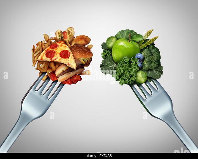 Diet struggle and decision concept and nutrition choices dilemma between healthy good fresh fruit and vegetables - Stock-Bilder