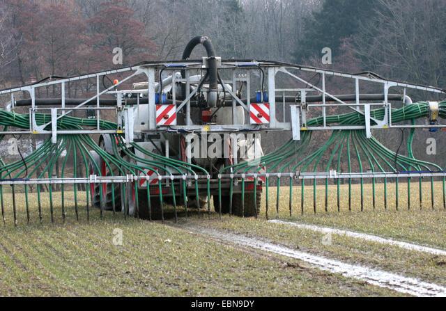 field fertilisation with drag hoses, Germany - Stock Image