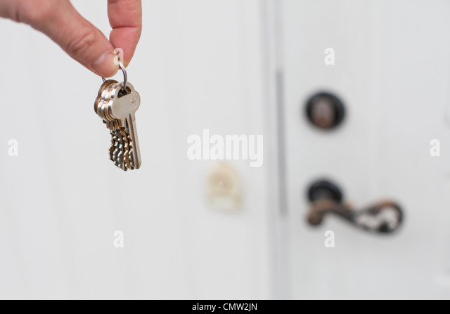 Person holding house keys - Stock Image