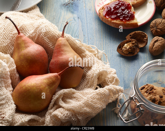 Pears, cookies, nuts and bread with jam - Stock Image