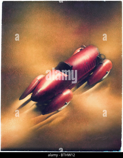 old metal red toy racing car Polaroid transfer - Stock Image