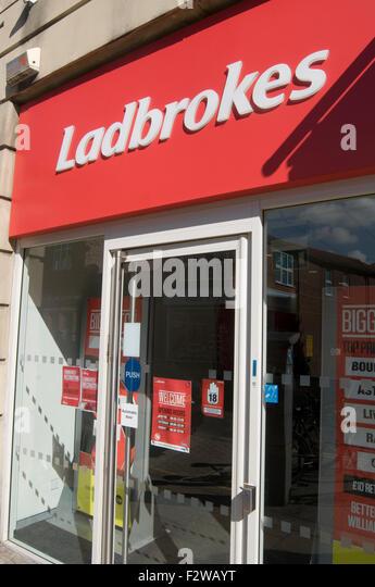 ladbrokes bookies bookie bet betting gambling high street branch - Stock Image