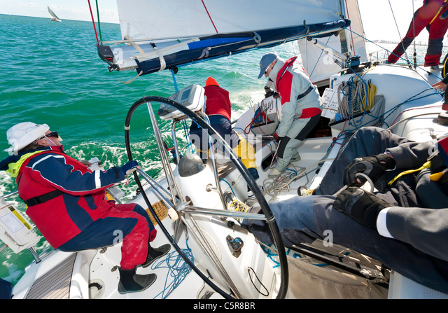 An offshore yacht racing crew busy sailing on the Ocean. - Stock-Bilder