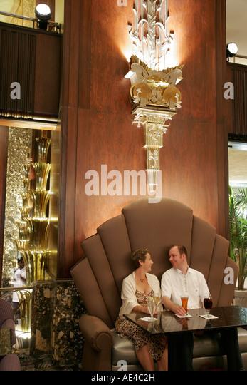 Ohio Cincinnati Hilton Netherland Plaza Palm Court Bar couple drinks Art Deco style - Stock Image