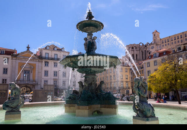City of Lisbon - Portugal. Fountain in Rossio Square (official name - Praca de D. Pedro IV). - Stock Image