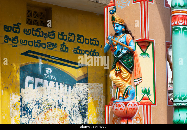 Krishna statue on an archway in an indian street. Andhra Pradesh, India - Stock Image