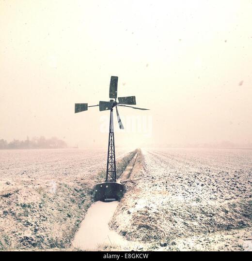 Wind turbine on field at winter - Stock Image
