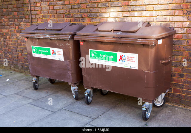Food waste brown recycling bins in Camden, London, UK - Stock Image