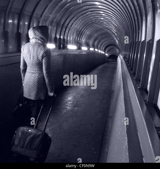 Walker at Park lane Darlington Passenger Tunnel with luggage, Darlington Station, Darlington, Teeside England, UK - Stock Image