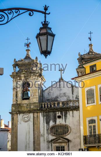 Coimbra Portugal historic center Igreja de Sao Bartolomeu Saint Bartholomew Catholic Church bell tower ornate lamp - Stock Image