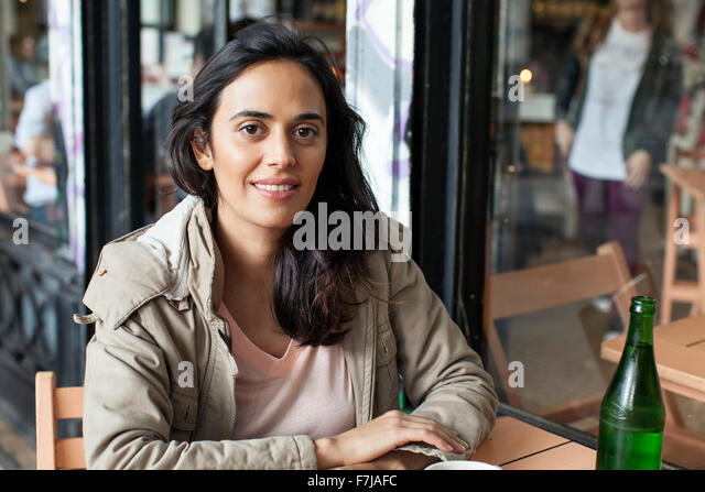 Woman at cafe - Stock Image