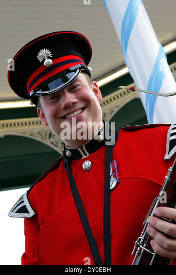 Musician and soldier, proudly posing whilst attending  The Shrewsbury Flower Show in August 2012. - Stock Image
