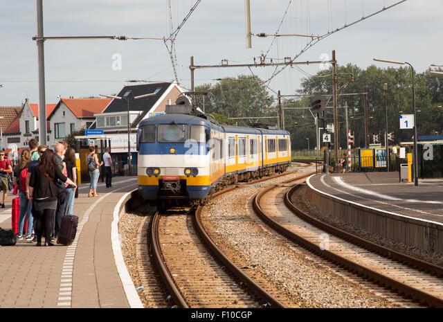 Sprinter passenger train arriving at platform, Hook of Holland, Netherlands - Stock Image
