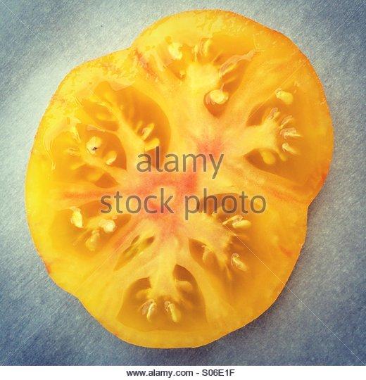 Gold Medal, heirloom tomato, slice - Stock Image