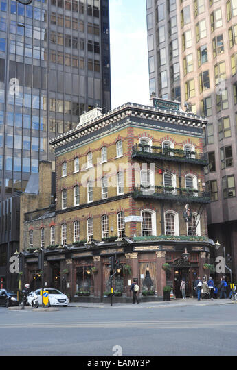 THE ALBERT- A WELL KNOWN VICTORIAN LONDON  PUB SURROUNDED BY TALL BUILDINGS VICTORIA ST  LONDON UK - Stock Image