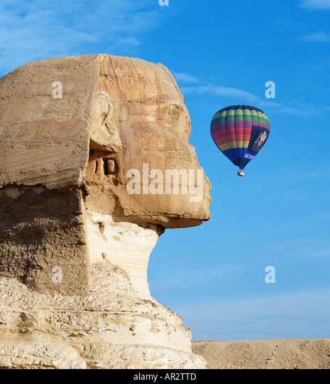 The Sphinx with hot air balloon Giza Cairo Egypt North Africa - Stock Image
