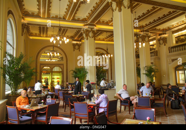 Hong Kong China Kowloon Tsim Sha Tsui Salisbury Road The Peninsula hotel inside interior lobby restaurant tables - Stock Image