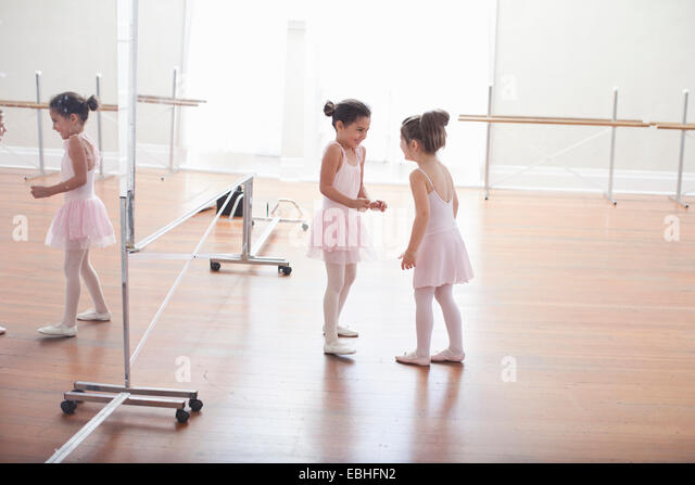 Two child ballerinas chatting in ballet school - Stock-Bilder