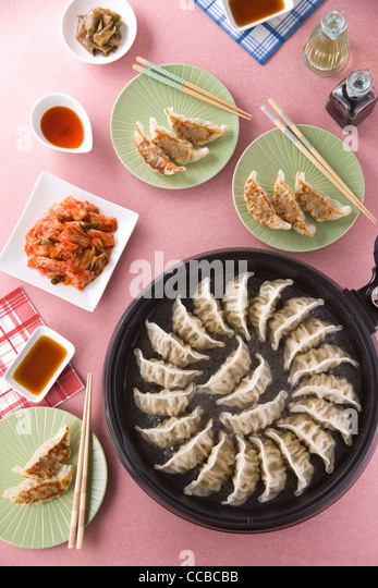 Pot Sticker on Hot Plate - Stock-Bilder