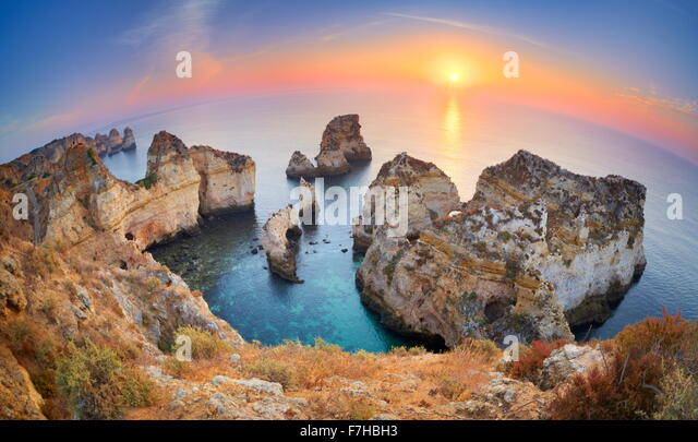 Sunrise at Algarve beach near Lagos, Ponta da Piedade, Algarve, Portugal - Stock Image