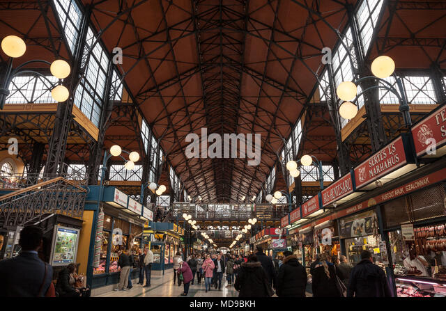 BUDAPEST, HUNGARY - APRIL 7, 2018: Interior of Budapest Great Market Hall (Nagy Vasarcsarnok) with a crowd in front. it is the biggest market hall of  - Stock Image