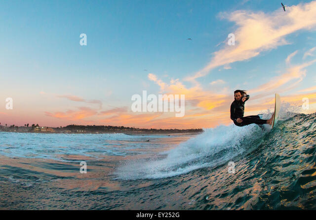 Young male surfer surfing a wave, Cardiff-by-the-Sea, California, USA - Stock Image